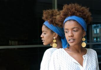 black woman in mirror behind