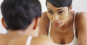 black woman in mirror